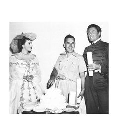 """Olivia de Havilland celebrating her 25th birthday with Errol Flynn on the set of """"They Died with Their Boots On"""","""