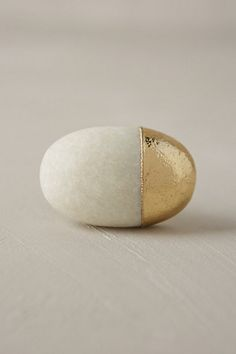 You could so easily DIY this knob with a stone, hardware, and spray paint. Stonecutter Knob - anthropologie.com