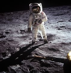 Buzz Aldrin on the Moon, 1969. Neil Armstrong and the LM are reflected in the helmet visor (AS11-40-5903)