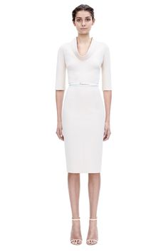 This is a fitted, structurally seamed dress, cut from a lightweight, soft, microbrush cotton. It has three quarter length sleeves and a gentle cowl neck. This dress comes with a contrasting white double-wrap leather belt, and the signature full-length back zip is exposed.