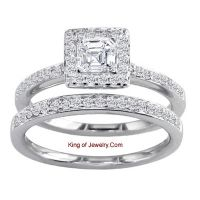 This remarkable diamond engagement set will leave you breathless with its unique design. Its centerpiece, a 1.02 carats Asscher cut diamond With clarity of VS2 and color of H, seamlessly levitates in the air. The diamonds on this ring have incredible brilliance!