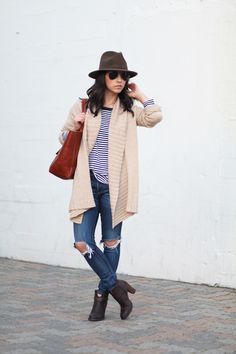Freshen up your winter wardrobe with stripes. Blogger Crystalin Marie layers a striped Gap tee under a cozy cardigan. Shop favorite striped pieces from Gap.