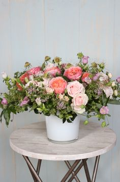 A dozen blush garden roses mingle with campanula and scabiosa blooms: 'Garden Rose Arbor' by Winston Flowers.
