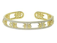 The Narrow Open Diamond Florentine Cuff features round diamonds pave set in 18K yellow gold accented by white rhodium. #judefrances