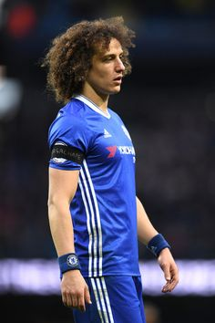 David Luiz of Chelsea wearing a black armband to commemoratethe victims of the plane crash involving the Brazilian club Chapecoense during the Premier League match between Manchester City and Chelsea at Etihad Stadium on December 3, 2016 in Manchester, England.