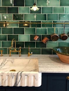 This picture is a little taster of what deVOL has to offer. Handmade kitchen cupboards, an exquisite fluted Arabescato marble sink, deVOL Aged Brass Taps, our Emerald Green Tiles and hand-aged hanging Green Kitchen Decor, Boho Kitchen, Copper Kitchen, Light Green Kitchen, Kitchen Cupboards, Kitchen Tiles, Kitchen Island, Küchen Design, Layout Design