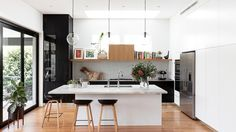 Kitchen revamp:mixing timber with stainless-steel surfaces. Photography by Tom Ferguson. Styling by Sarah Johnson.