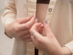 Ring is open and cosy in finger, when turning around it change the form. Playful and beautiful Otava, silver 925.