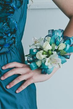 Every prom dress needs a gorgeous matching corsage! This beautiful teal corsage is created with white flowers and accented with clear rhinestones. Stunning piece to go with a stunning dress! Design by The Front Porch Flowers & Gifts.