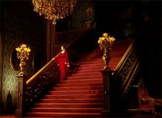 Vivian Leigh as Scarlett O'Hara on the grand red carpeted staircase in Gone with the Wind stairs stairs stairs