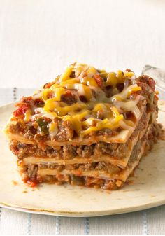Our Favorite Mexican-Style Lasagna. Create a little fusion with ooey-gooey KRAFT Mexican Style Shredded Cheese, beans, and taco beef layered up and baked like a lasagna. Mexican Dishes, Mexican Food Recipes, Beef Recipes, Cooking Recipes, I Love Food, Good Food, Yummy Food, Comida Latina, Le Diner