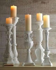 Lamp bases repurposed into candle sticks.