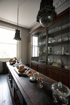 Alex MacArthur's re-purposed cabinets against the kitchen wall and as the central island.