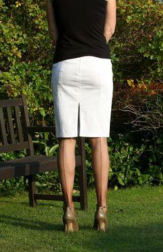 Visible Garter Bumps Under White Pencil Skirt Black Top Sheer Black Back Seam Stockings and Black High Heels