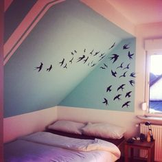 Bird wall graphic in bedroom with bird nest/tree four poster bed