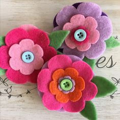 No Sew felt flower brooches using First Edition flower nesting dies search Trimcraft in YouTube to see how they are made