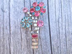 Vintage floral bouquet brooch clear pink blue rhinestones figural AC060