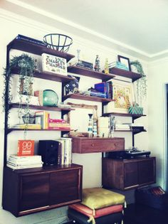 where do these shelves come from and how do they get to my house? Justina Blakeney: TOUR THE JUNGALOW Mid Century Wall Unit, Mid Century House, Living Room New York, Home And Living, Shelving Design, Wall Shelving, Wall Storage, Home Goods Furniture, I Love House