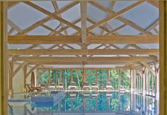 Oak framed swimming pool by Clague LLP