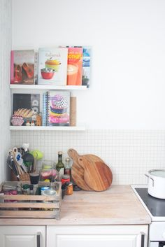 DIY idea: small ledges in kitchen for front facing cookbooks