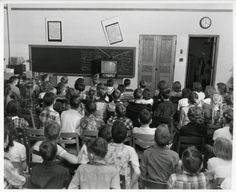 Denver on January 20, 1953:   Students at Steele Elementary School crowd around a tiny television set to watch the inauguration of President Dwight D. Eisenhower. Television was barely a year old in Colorado — the state's first TV station only started broadcasting in 1952.