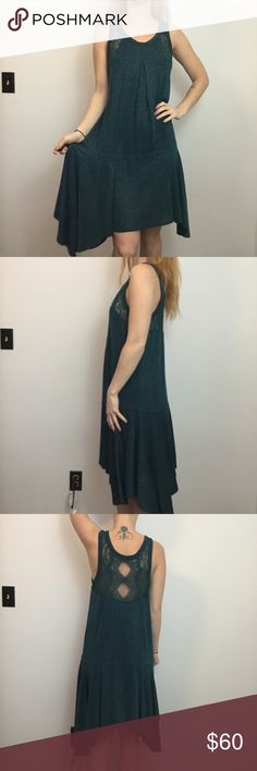 Free People Green Sleeveless Polka Dot Asymm Dress Free People Dress Asymmetrical and has a green body, stretchy all over and has lace detaIl In the back. Size medium. No wear. Free People Dresses