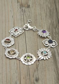 Sterling silver bracelet contains seven silver charms that correspond to the seven Chakras. Each charm is inlaid with a colorful semi-precious stone. Chakra Jewelry, Chakra Bracelet, Yoga Jewelry, Spiritual Jewelry, 7 Chakras, Silver Charm Bracelet, Silver Charms, Bracelet Charms, Copper Bracelet