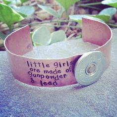 Hand Stamped Tag Girls are made of gunpowder and lead bracelet with shotgun shell accent on Etsy, $35.00