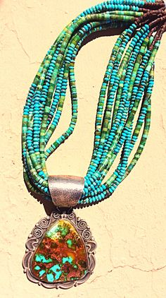 Pilot mountain high grade natural stone pendant set in sterling silver with Turq and green beads.