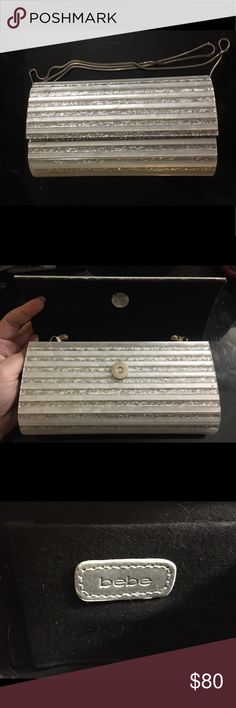 Bebe Hard Silver Clutch Hard clutch, with silver chain. Very study, won't bend, high fashion, glitzy. bebe Bags Clutches & Wristlets