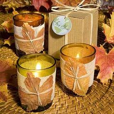 Glass votives with leaves to decorate.