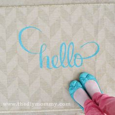 Super cute welcome mat with a little paint and a cheap Ikea rug.