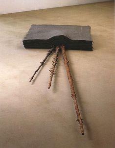 Joseph Beuys. felt and tree parts.