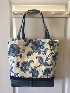 The Brooke Bag is a blue and white floral with a sturdy dark blue denim bottom, which includes a navy blue trim! The tote is fully reversible, with a matching blue ultrasuede fabric, and double jeans pocket inside. Denim Tote Bags, Denim Handbags, Denim Purse, Diy Tote Bag, Tote Bags Handmade, Diy Bag Designs, Potli Bags, Diy Bags Purses, Boho Bags