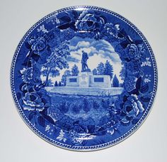 This vintage Wedgwood pottery blue and white commemorative plate is of the World War Memorial, Augusta, Maine.