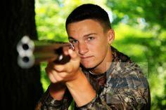 Jake - www.michelesheets.com  #senior #pics # boys #guns #outdoors @Nancy Homann