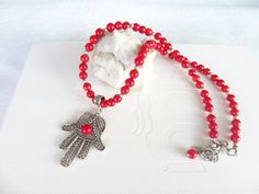 Hey, I found this really awesome Etsy listing at https://www.etsy.com/listing/215745556/red-coral-hamsa-necklace-hand-of-fatima
