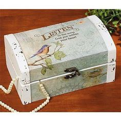 """Listen"" Keepsake and Decorative Box by Walk By Faith Gifts. $18.07. Hinged lid with antique brass-tone latch and textured fabric lining.. Measures 9 1/4"" x 4 1/2"" x 5 5/8"".. Hardboard wood with a distressed design.. In a protective white box.. Product Text: LISTEN to the song God put within your heart.. ""Listen"" Box - Trunk-style box fits dresser and desktops perfectly and is sized to hold keepsakes, jewelry, desk supplies and other small items. Hardboard wood with..."