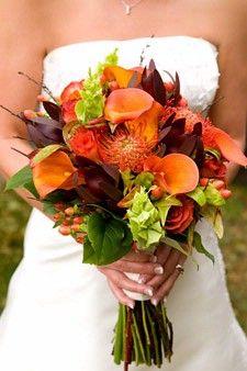 Orange mini callas, sunset sarfari, orange protea, bells of ireland, orange roses, and hypercium berries.