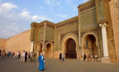 https://flic.kr/p/6Tnc3E | Bab Mansour in Meknes , Morocco (Unesco world heritage) |  Buy this photo on Getty Images : Getty Images   Bab Mansour gate, named after the architect, El-Mansour. It was completed 5 years after Moulay Ismail's death, in 1732. The design of the gate plays with Almohad patterns. It has zellij mosaics of excellent quality. The marble columns were taken from the Roman ruins of Volubilis. When the structure was completed, Moulay Ismail inspected the gate, asking…