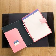 Pre-hole punched and perforated pink notebook