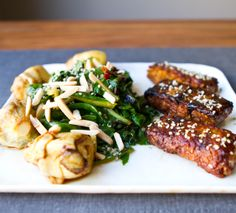 sticky sweet blackened tempeh with apple cider vinegar chard, slivered almonds, charred artichoke hearts, & raw hemp seeds
