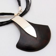 Ebony and silver combine in this delicate, beautiful pendant.