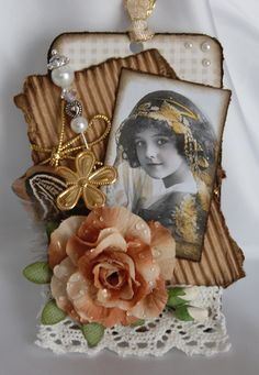 Beautifully detailed heritage photo tag with corrugated cardboard, lace, jewelry and dimensional flower.