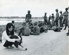 Nick Ut, After Bidding Farewell to her Boyfriend, a South Vietnamese Lieutenant, This Vietnamese Girl Sadly Sits on her Wooden Sandals While...