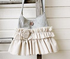 Make this with the fabric from Easton's backdrop and the floral I bought the other day with Cory.  Go ahead and make 2.  Vintage Ticking & Ruffles Bag