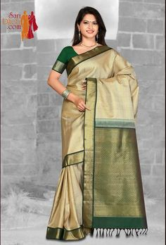 Offwhite color body with green color Korvai border #kanchipuramsarees at http://www.saridhoti.com