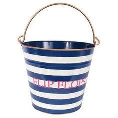 Recycled metal storage pail with hand-painted stripes.  Product: PailConstruction Material: Recycled metalColor: Navy blue and whiteFeatures: Hand-paintedDimensions: 11 H x 12 Diameter