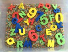 Our Alphabet and Numbers Sensory Bin (Starting Preschool Sensory Bin) - It contains rainbow dyed rice (dyed with kool aid for additional sense of smell), foam letters and foam numbers.  Letters and numbers are from the dollar section at Target - Preschool Activity