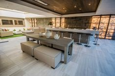 A luxury desert contemporary showhome was conceived by design-build firm Blue Heron, sited in Seven Hills in the McCullough Mountains of Henderson, Nevada.